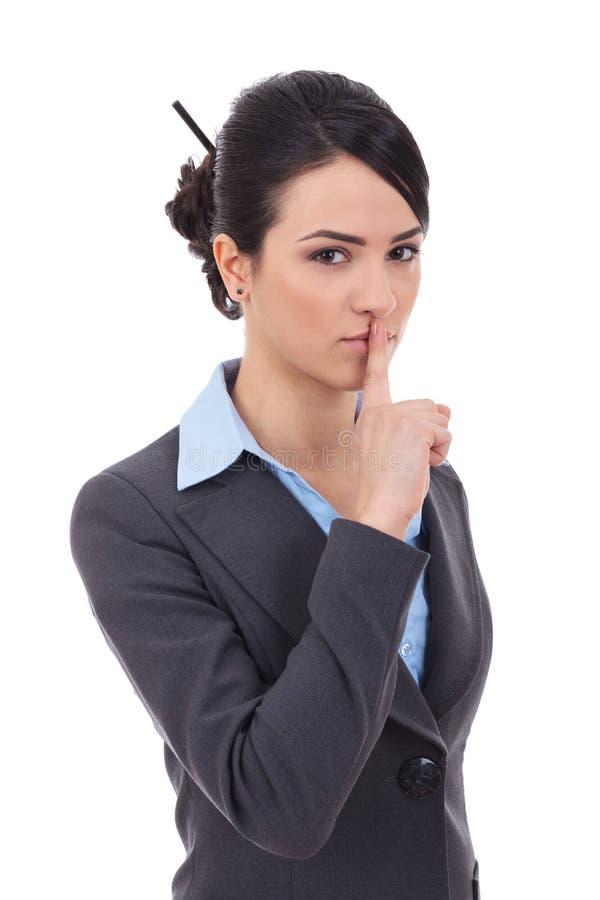 Vrouw die stilteteken maken stock foto