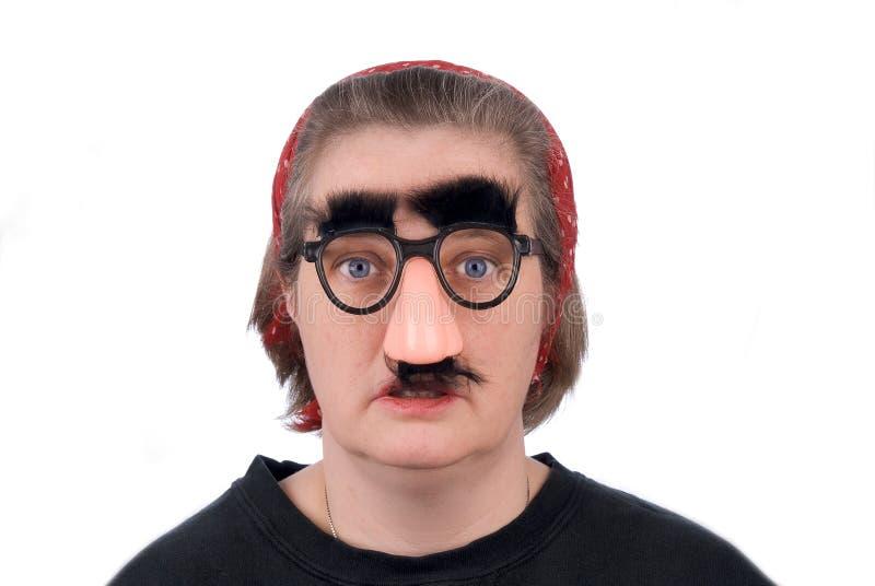 Vrouw die valse neus draagt en gl stock afbeelding
