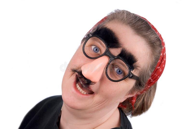 Vrouw die valse neus draagt en gl stock afbeeldingen