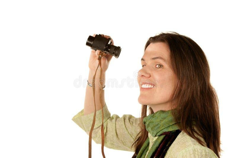 Vrouw die verrekijkers met behulp van royalty-vrije stock foto