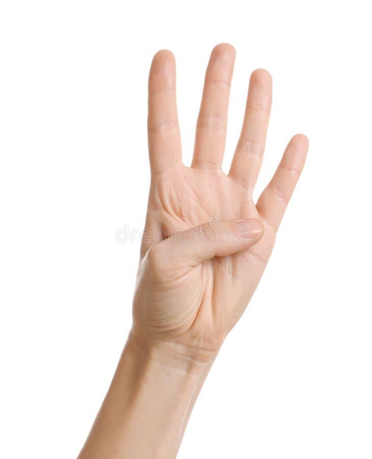 Vrouw die vier vingers op witte achtergrond tonen royalty-vrije stock afbeelding
