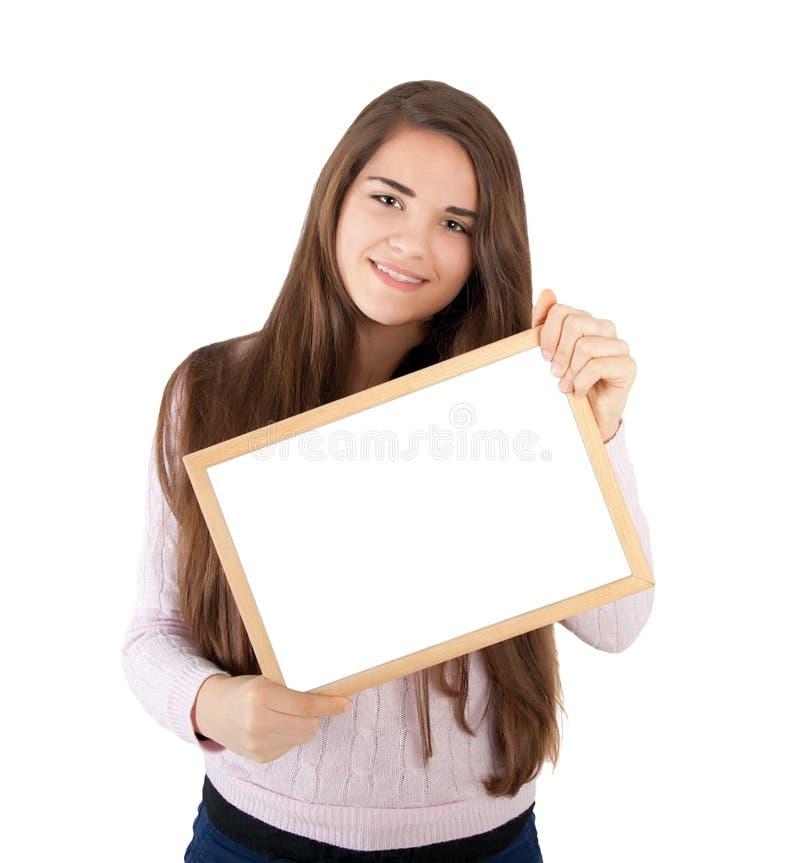 Vrouw die witte raad houden stock afbeeldingen
