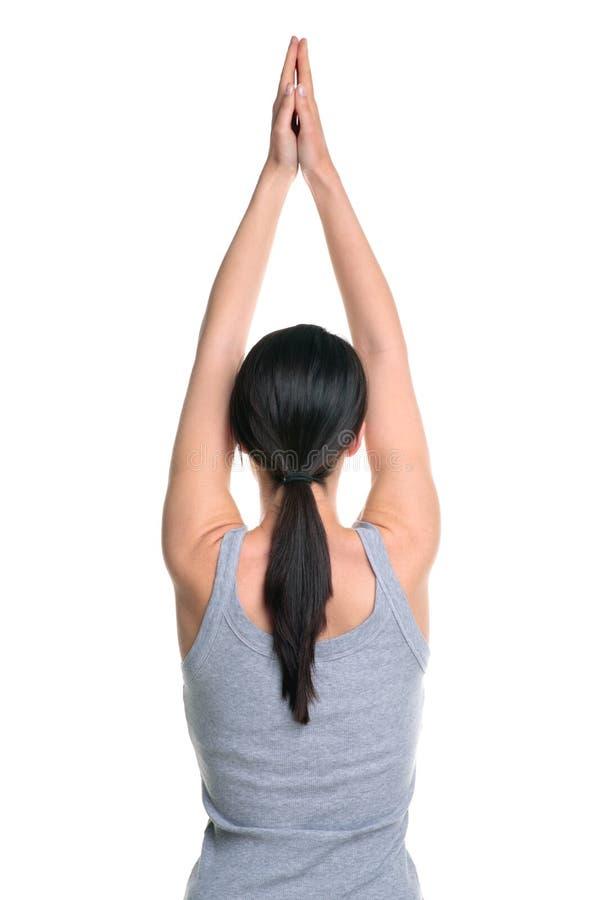 Vrouw die yoga achtermening doet stock foto's