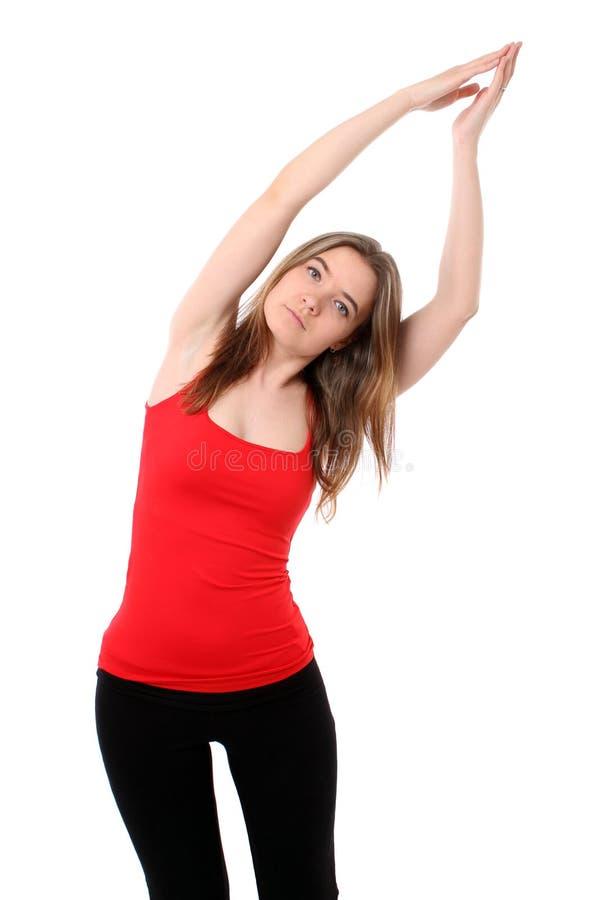 Vrouw die yoga doet royalty-vrije stock afbeeldingen