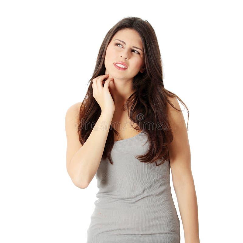 Vrouw die zelf haar scraching stock foto's
