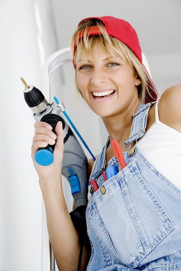 Vrouw DIY stock afbeeldingen