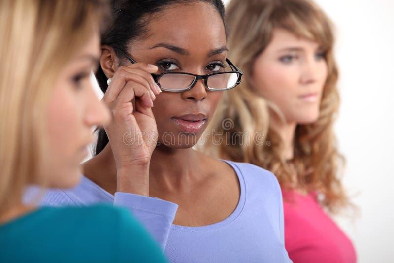 Vrouw drie in een rij. royalty-vrije stock foto