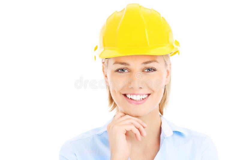 Vrouw in een bouwvakker stock foto