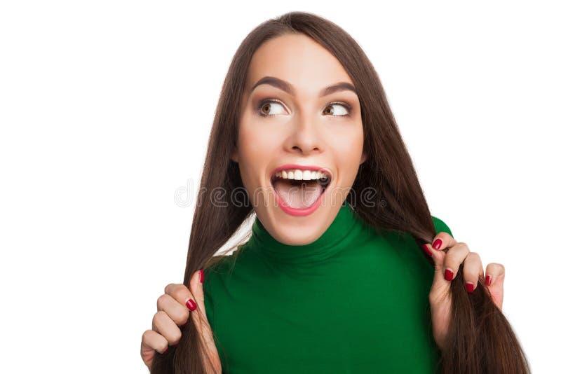 Vrouw in een groene col stock foto's