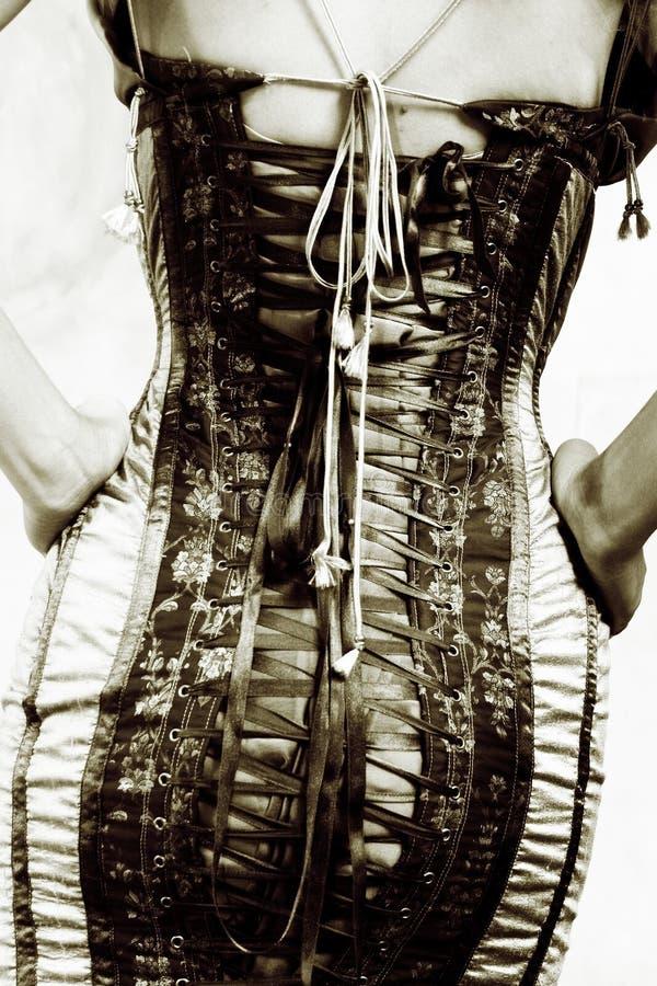 Vrouw in een korset royalty-vrije stock fotografie