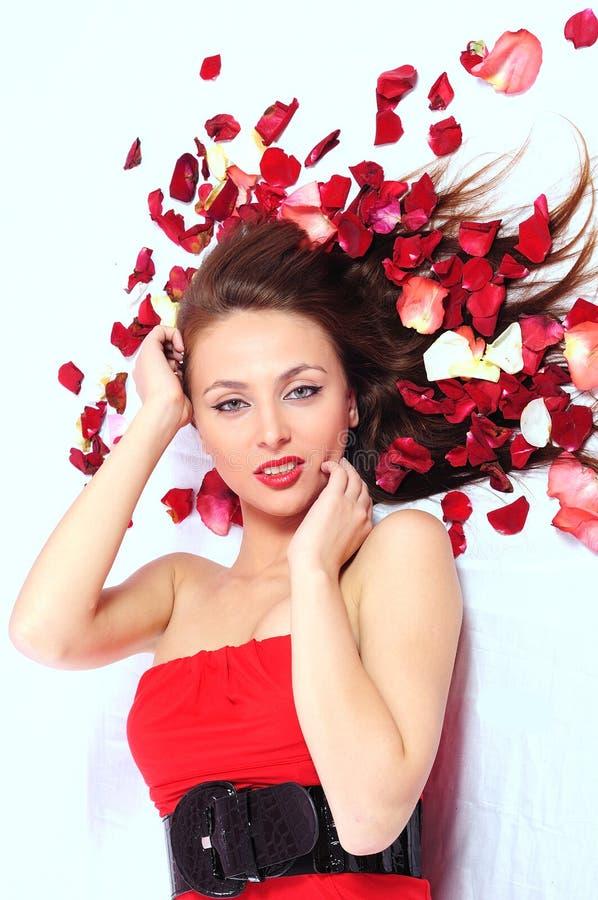 Vrouw in een rode kleding stock afbeelding