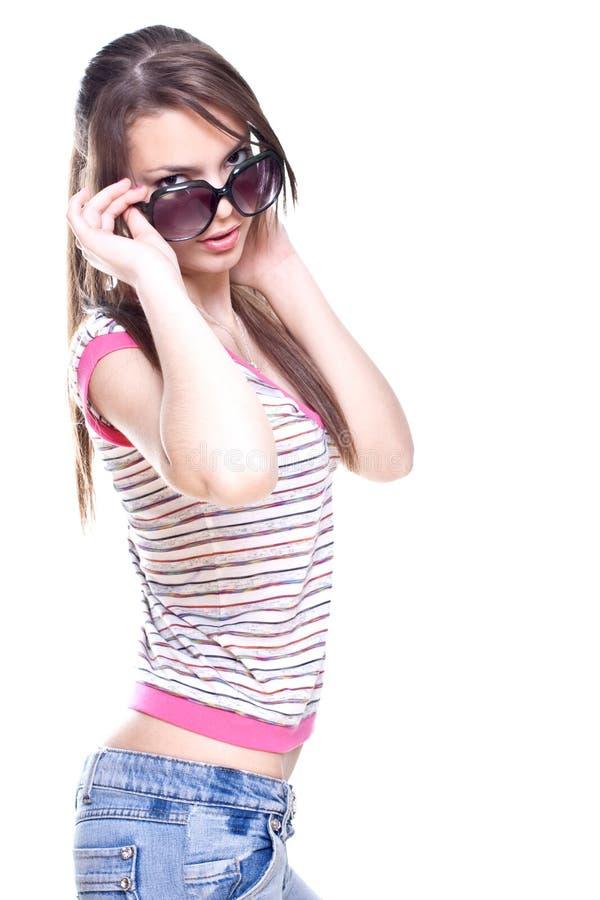 Vrouw in een roze overhemd met de glazen stock fotografie