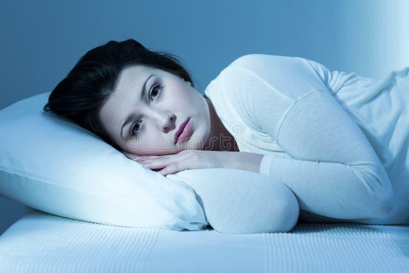 Vrouw en gebrek aan slaap stock afbeeldingen