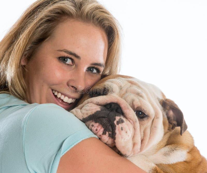 Vrouw en haar hond stock fotografie