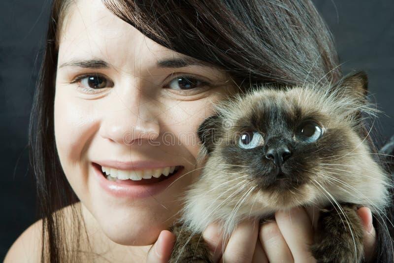 Vrouw en kat royalty-vrije stock afbeelding