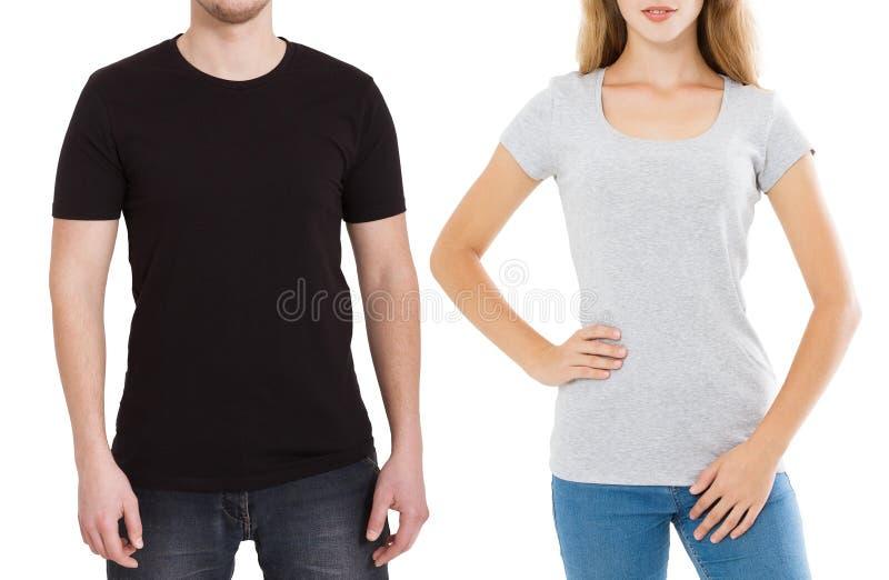 Vrouw en man in lege die malplaatjet-shirt op witte achtergrond wordt geïsoleerd Kerel en meisje in t-shirt met exemplaar omhoog  stock afbeeldingen