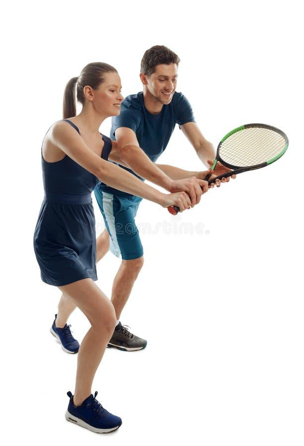 Vrouw en man speeltennis royalty-vrije stock afbeelding