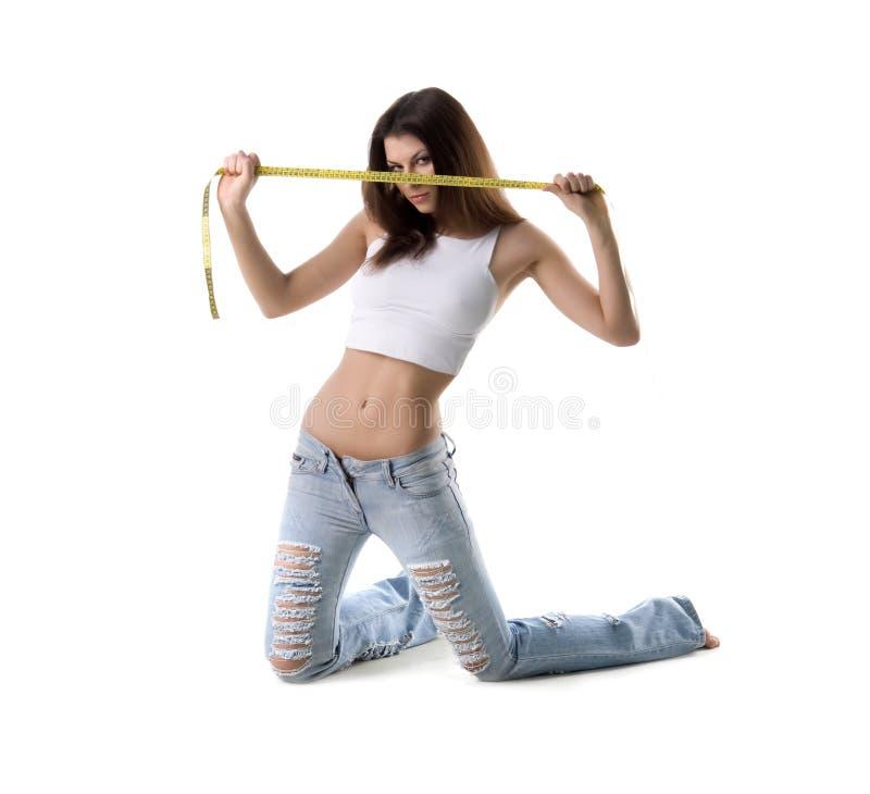 Vrouw en meetlint stock afbeeldingen