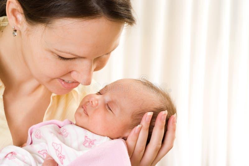 Vrouw en pasgeboren stock afbeeldingen