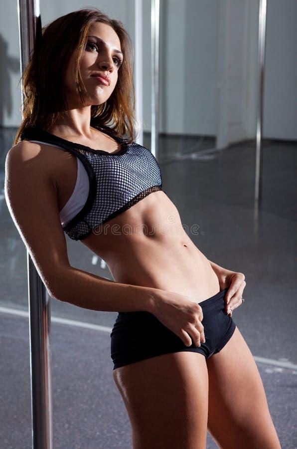 Vrouw en pool-dans stock fotografie