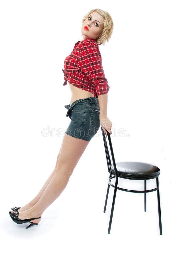 Vrouw en stoel stock afbeelding