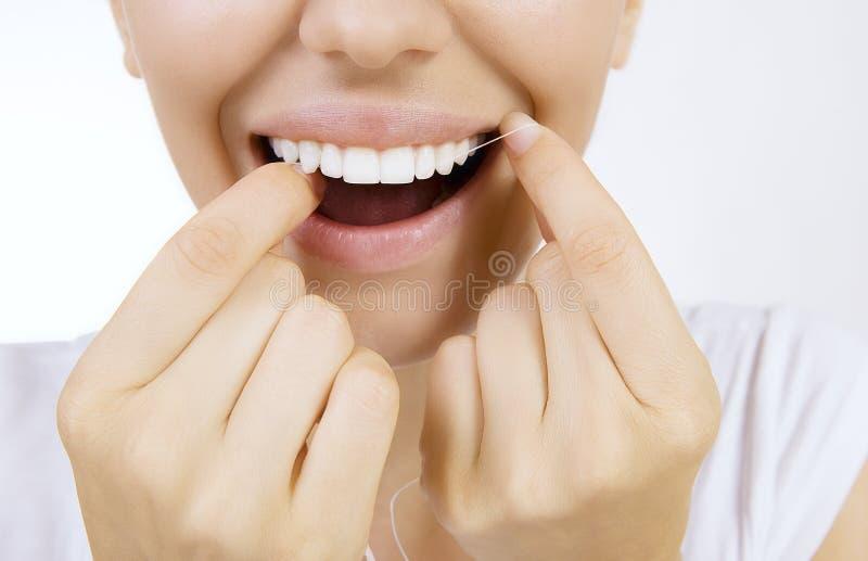 Vrouw en tandenzijde stock fotografie