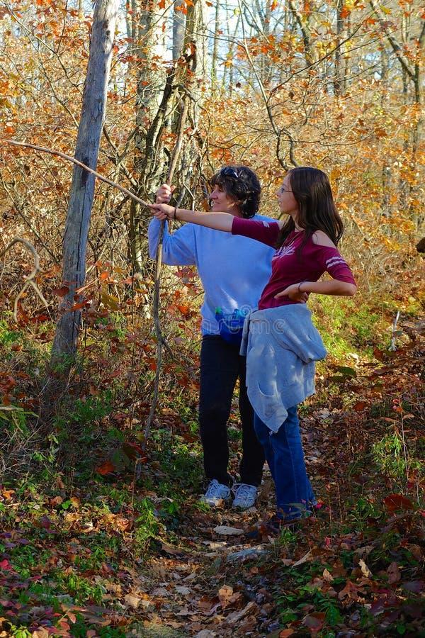 Vrouw en Tiener op Stijging stock afbeelding