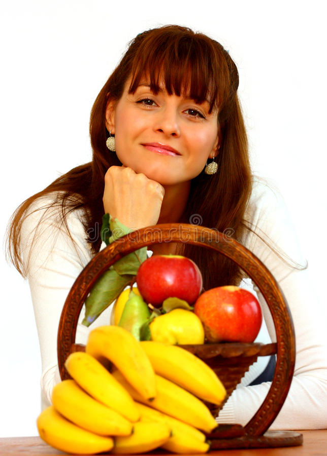 Vrouw en vruchten stock afbeeldingen