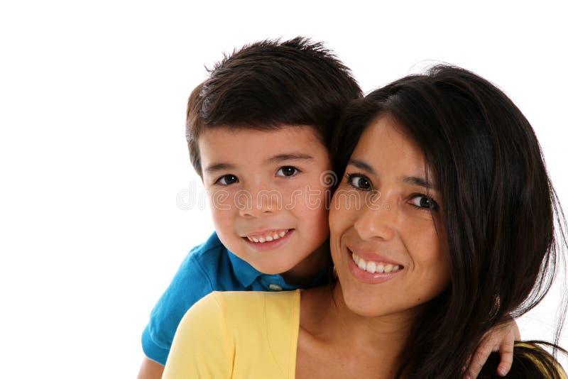 Vrouw en Zoon op Witte Achtergrond stock foto's