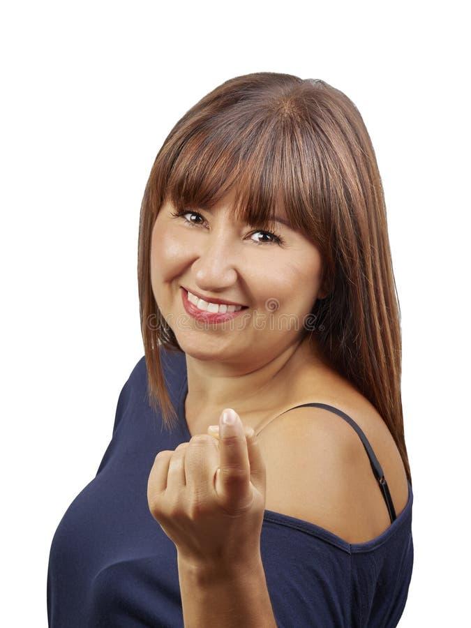 Vrouw het gesturing komt hier roepend geïsoleerd u stock foto
