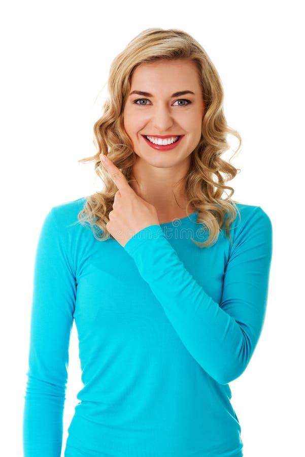 Vrouw het gesturing met vinger stock afbeelding