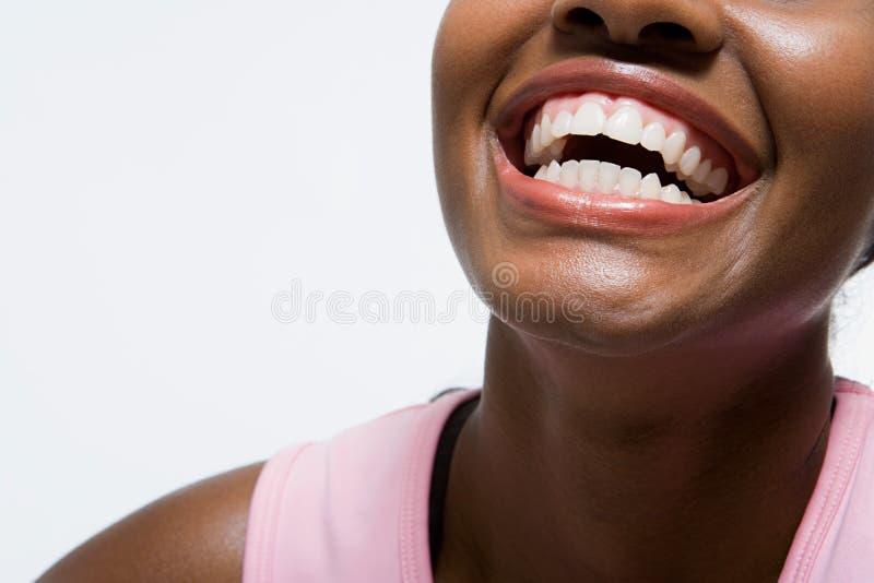 Vrouw het glimlachen royalty-vrije stock afbeeldingen