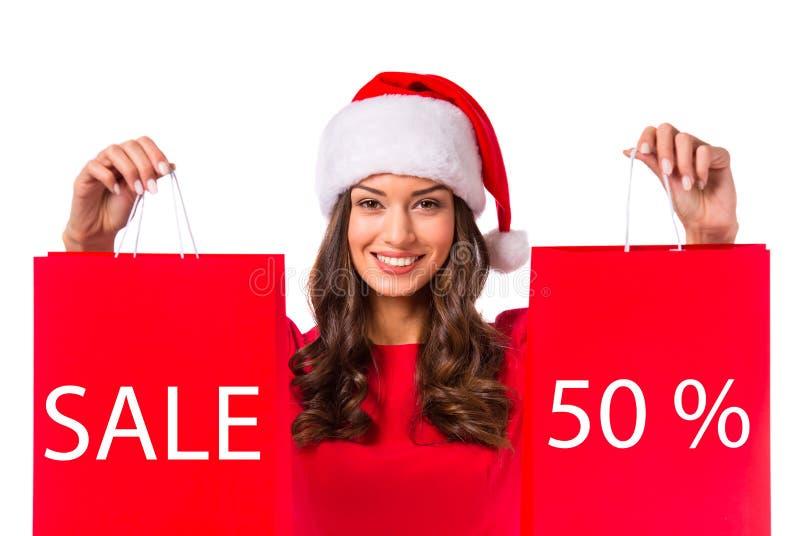 vrouw het vieren Kerstmis stock foto