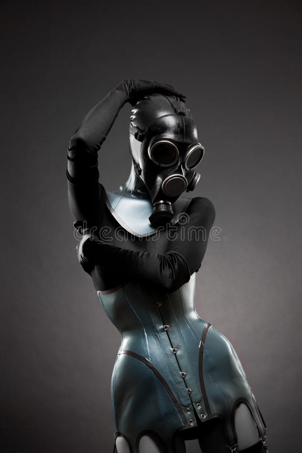 Vrouw in latexkorset en gasmasker royalty-vrije stock foto