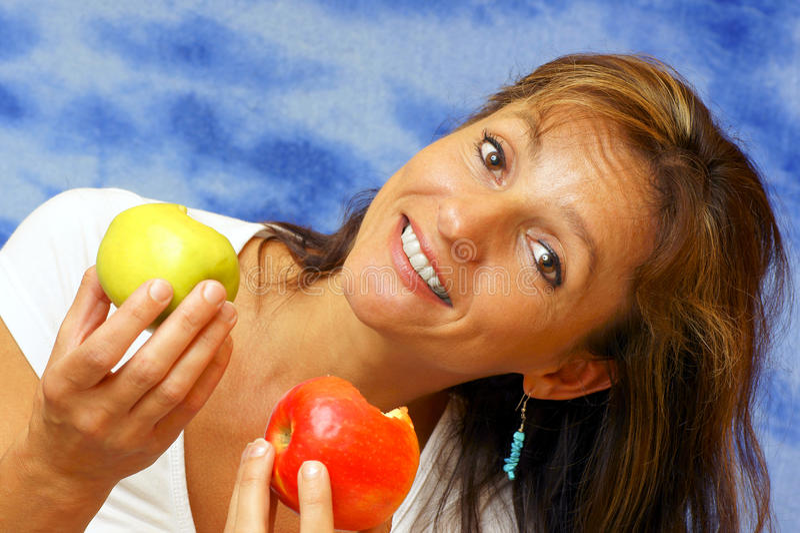 Vrouw met appel. royalty-vrije stock foto's