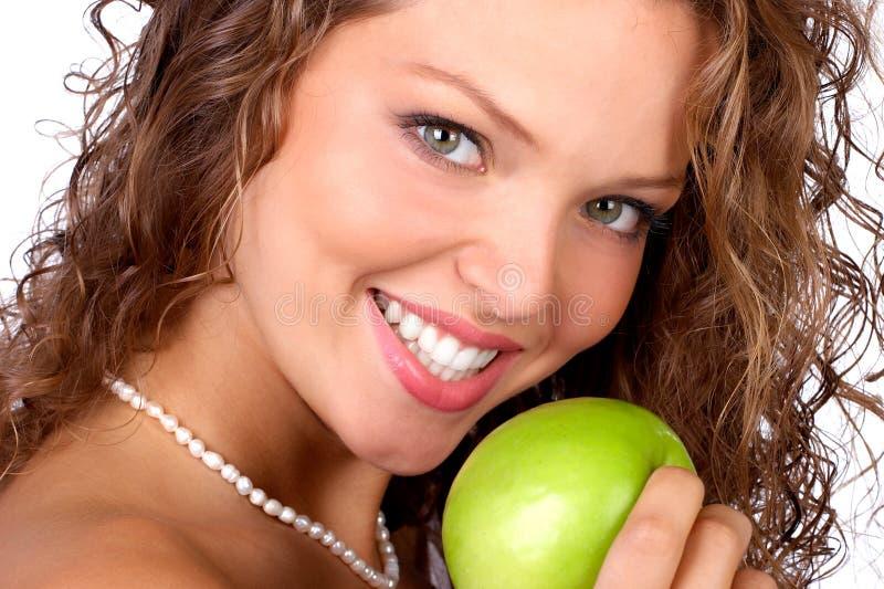 Vrouw met appel royalty-vrije stock foto