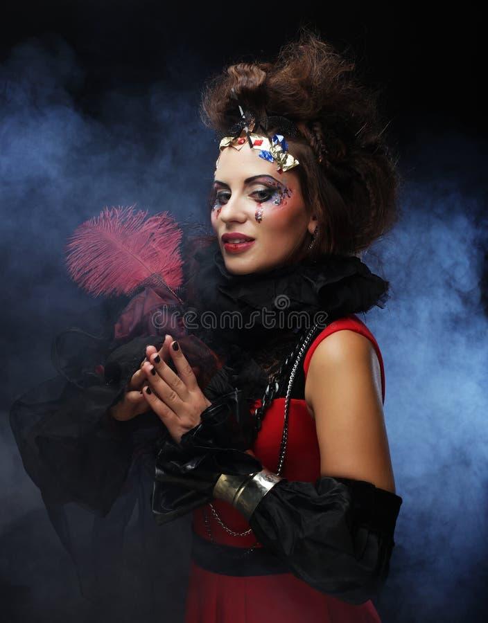Vrouw met artistieke samenstelling in blauwe rook royalty-vrije stock fotografie