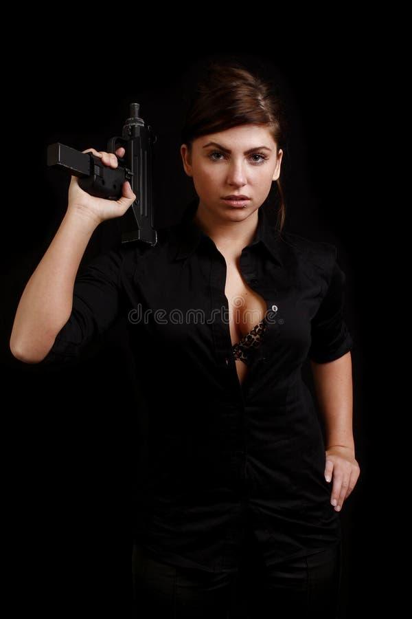 Vrouw met automatisch pistool royalty-vrije stock fotografie