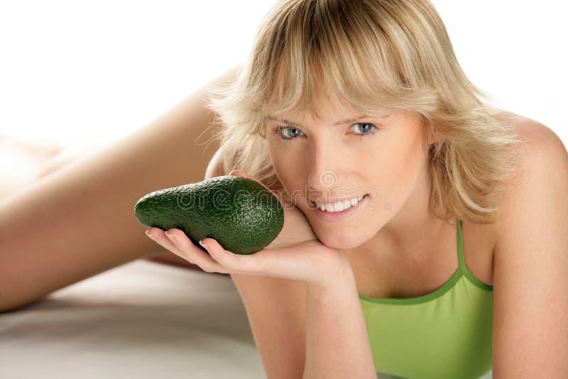 Vrouw met avocado royalty-vrije stock foto's