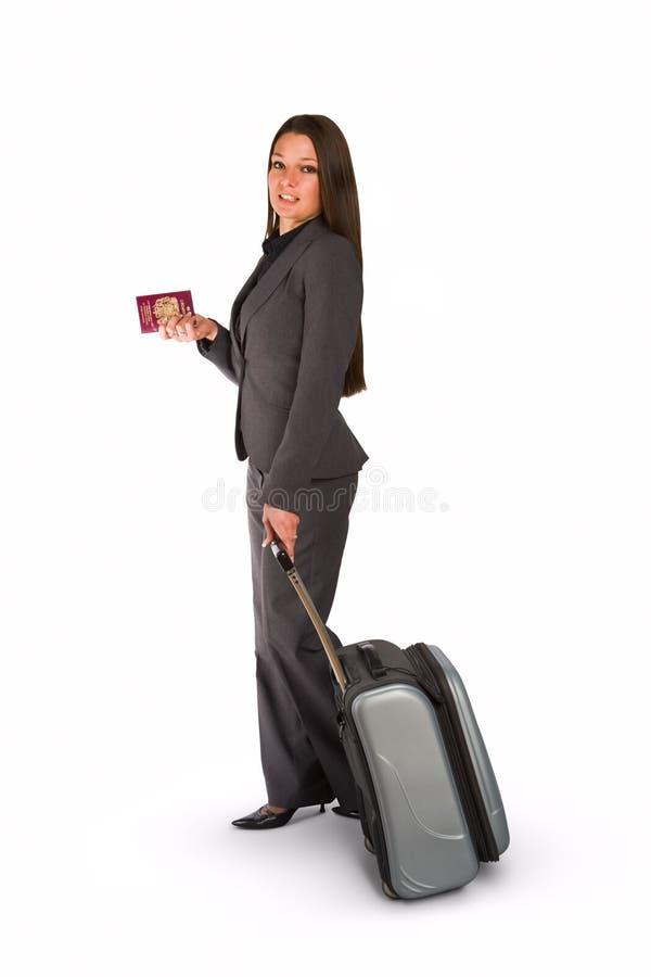 Vrouw met bagage en paspoort stock afbeeldingen