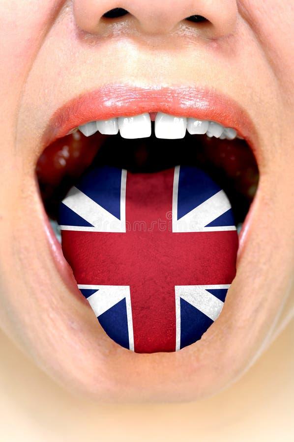 Vrouw met Britse Vlag op Haar Tong stock fotografie