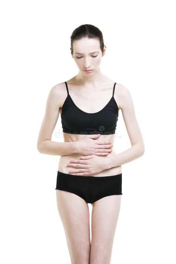 Vrouw met buikpijn Pijn in het menselijke lichaam royalty-vrije stock fotografie