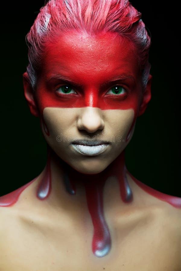 Vrouw met creatieve gezicht-kunst royalty-vrije stock foto