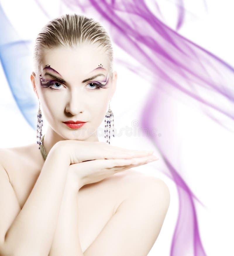 Vrouw met creatieve samenstelling royalty-vrije stock afbeelding