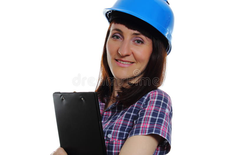Vrouw met documenten die beschermende blauwhelm dragen stock afbeelding