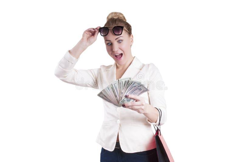Vrouw met dollars het winkelen zakken, geïsoleerde verrassing royalty-vrije stock foto's