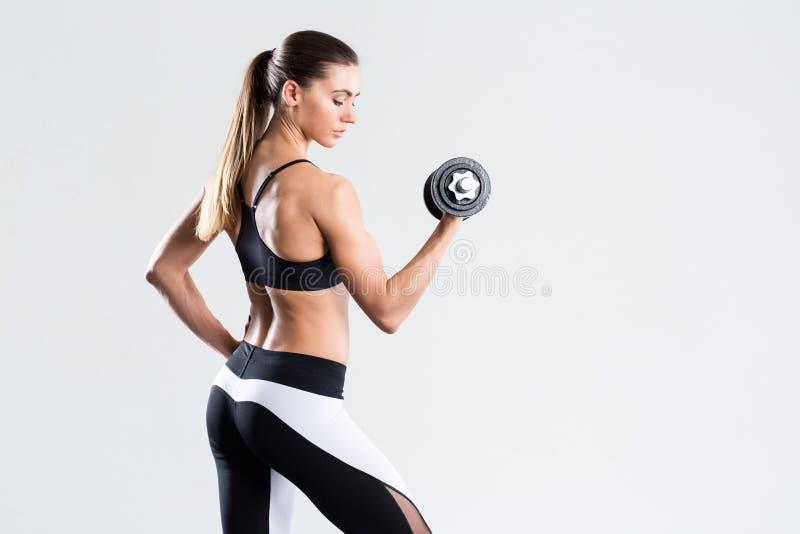 Vrouw met domoor geschikt slank abs lichaam stock afbeeldingen