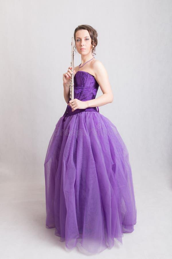Vrouw met een fluit royalty-vrije stock foto's