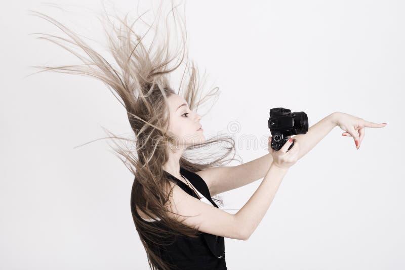 Vrouw met een fotocamera stock fotografie