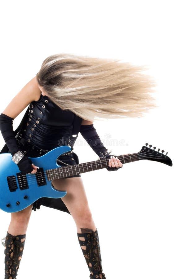 Vrouw met een gitaar stock afbeelding